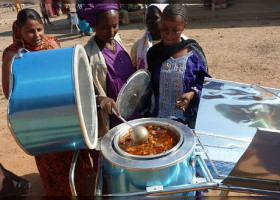 SOLAR COOKER (uses sun energy, gas, briquettes, biogas or small quantities of wood for cooking).